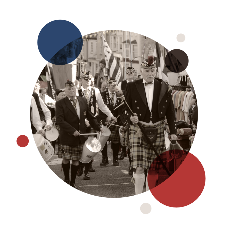 Band wearing Cornish Tartan marches through the town centre as part of Penryn Fair Day